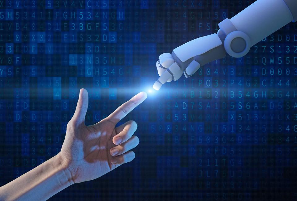 Imagem de uma mão humana tocando a mão de um robô